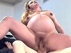 Preggy blonde fucks and gets facial