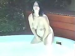 Cute pregnant chick has fun in pool