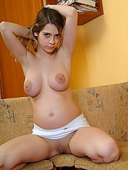 Brown eyed brunette teen shows off her pregnant body