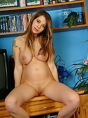 A barely legal babe shows off her expectant body