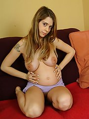 Brown eyed babe exposing her naked pregnant ass