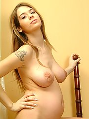 A pregnant teen shows off her tattoos and her titties