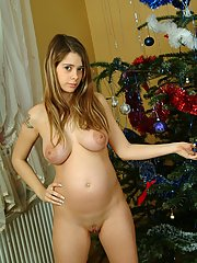 Nina poses naked with her Christmas tree in these pics